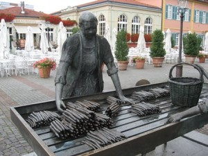 A tribute to the asparagus vendors that make Schwetzingen famous. The Schwetzingen Hausbrauerei zum Ritter shows in the background.